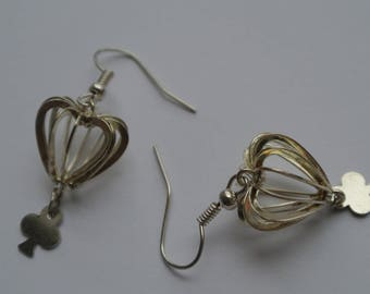 pair of earrings heart cage