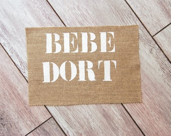 "Interleave for creation DIY Message ""Baby DORT"" on linen rough textile decoration"