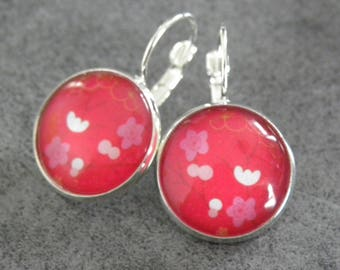 Silver with red cabochon earring