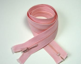 Zipper closure, 53 cm, not separable, pink, 4 mm plastic mesh.