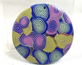 Round cabochon of 4.2 cm: colorful bubbles.