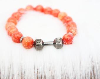 Men's orange gems and barbell charm beaded bracelet