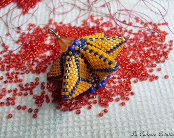 Pendant or piece for creating orange and Royal Blue