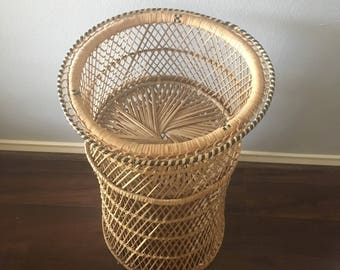 Tall wicker plant stand.