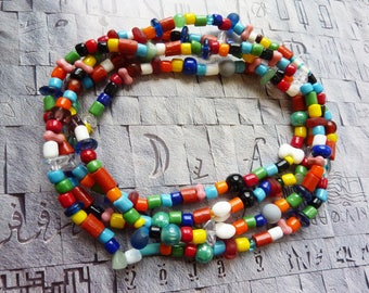 Long beaded necklace multicolored, multifaceted and multimaterials