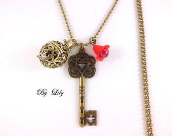 Long perfume, filigree and red acrylic flower key!