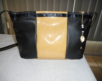 Black and gold shoulder bag