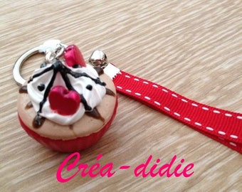 Cupcake keychain and whipped cream.