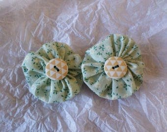 set of two clips made with yoyo flowers in shades of green and white