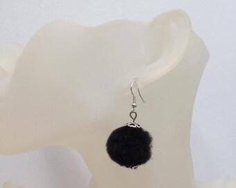 Round soft black tassel earrings