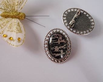 Silver and black holder hand painted oval brooch silver metal