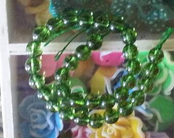 strands 32 beads quartz olivine 6 mm diameter, hole 1 mm
