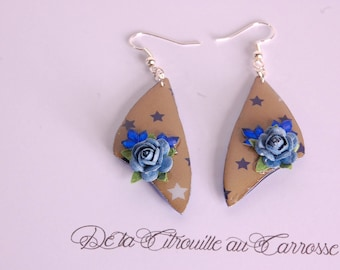 Earrings blue stars, taupe background