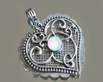 Silver double heart, filigree and laion pendant