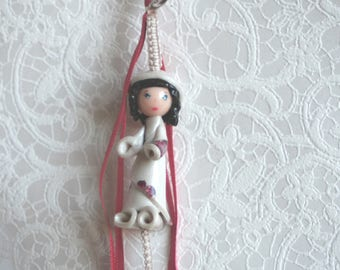 Bag charm modeling Nenette ivory and Burgundy