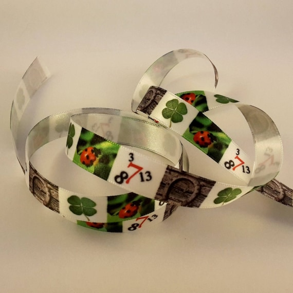 Pattern luck on a white satin ribbon