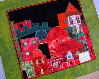 Canvas patchwork of red and green houses