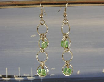 Earrings in silver copper rings and glass beads