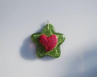 Plastic pendant 50 mm Green glitter star