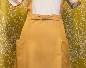 Yellow daydress with pockets and bows