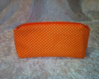 Clutch orange white polka dots patterned