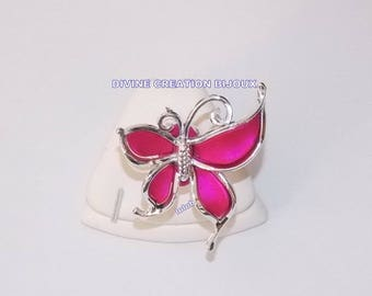Adjustable ring depicting a butterfly in resin