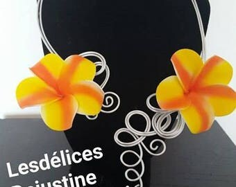 Silver necklace with yellow and orange foam flower
