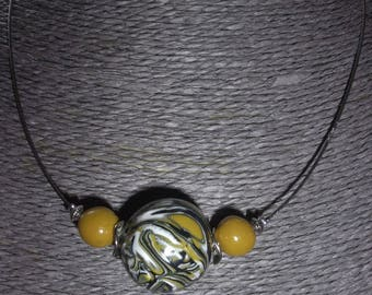 Choker necklace with yellow, mustard, grey, black and white round beads