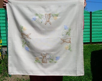beautiful tablecloth has the embroidered Bunny