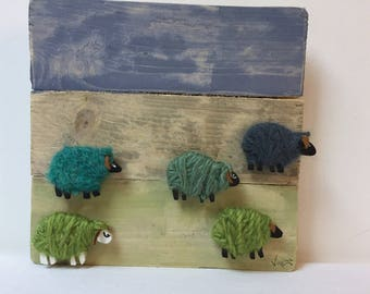 Made of wood and dressed in wool sheep