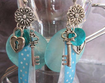 """Earrings has large mother of Pearl sequins and """"key to my heart"""" charms"""