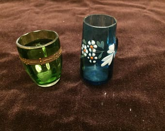 Pair of hand painted Cordial glasses 1, Emerald Green with 24k gold paint, 1 Blue w/handle White Floral Motif