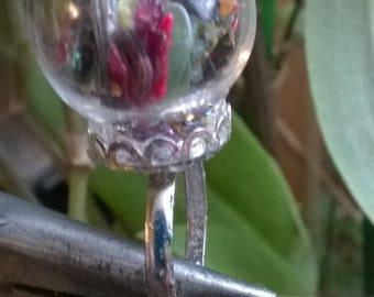 Ring adjustable glass ball