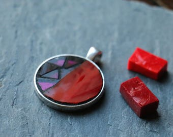 Small round pendant with red and purple stained glass mosaic