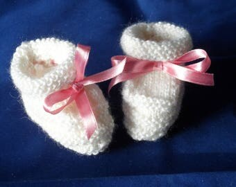 Little white hand knitted baby booties