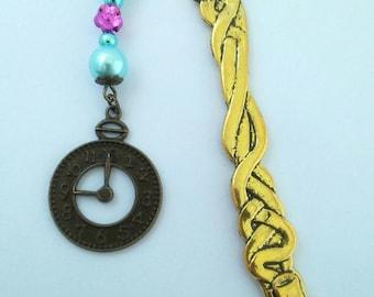 "Large gold bookmark ""teapot and clock"""