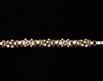 Vintage 1960s Signed Florenz Bracelet With Iridescent And Green Rhinestones And Seed Pearls In The Shape Of Flowers