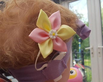 2x Pink and yellow cochlear implant flower bow