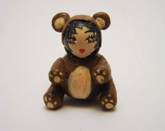 Doll dressed as a bear