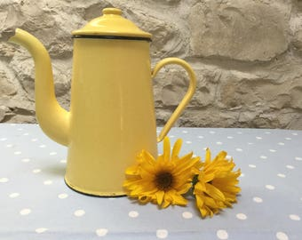 Bright yellow French coffee pot
