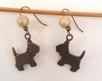 CREAM DOG EARRINGS