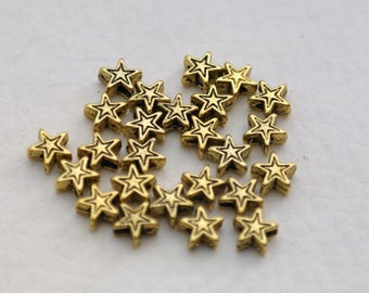 Set of 10 spacer beads color gold gilt stars