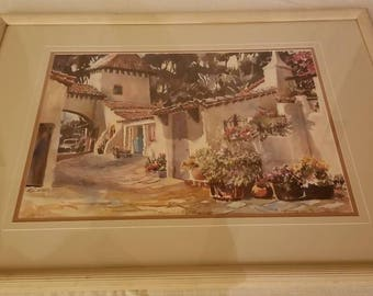 "Raleigh Kinney Watercolor Signed and numbered (284/500) Print ""Spanish Village"" that is Framed and Matted Behind Glass."
