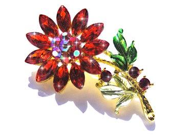 Broche fleur doré cristal et strass rouge et AB.