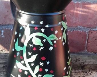 Hand painted metal jug