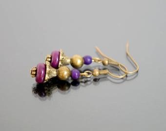 Earrings bronze and purple.