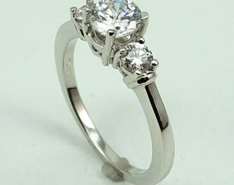 Platinum Engagement Ring CZ Center Stone with 2-Diam Side Stones at 0.31 Cts.
