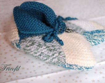 Green and white booties made for adult hand