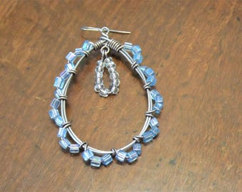 Intricate blue wire-wrapped teardrop hoop earrings
