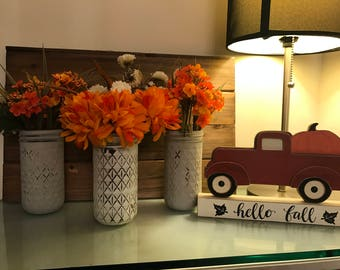 Painted set of mason jars with flowers